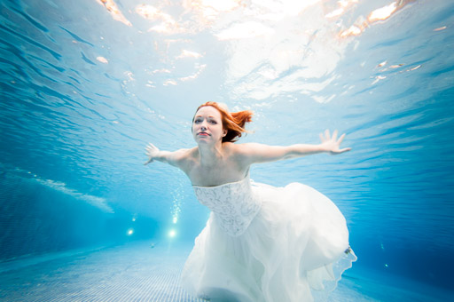 Woman Swimming Underwater In Dress