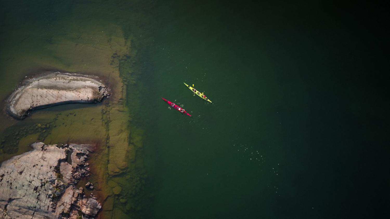 Family sea kayak camping trip to crown land islands on the north shore of Georgian Bay near Killarney, Ontario, Canada