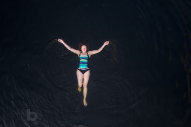 Aerial photo of a woman (40) swimming in a lake in the Kawartha cottage region near Haliburton, Ontario, Canada